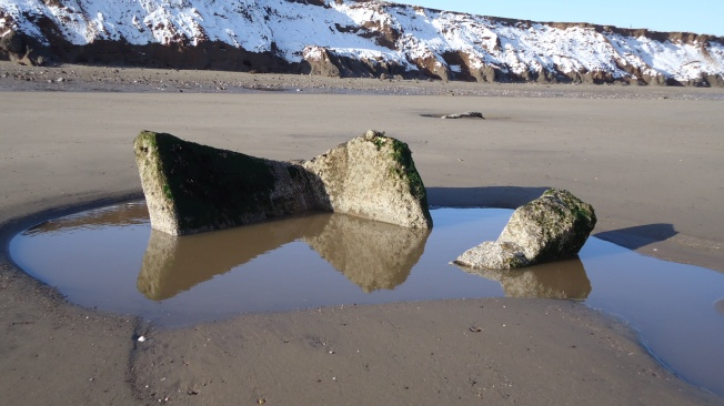 Wartime observation post tipped over the edge at Mappleton beach